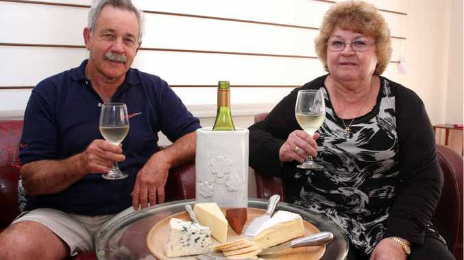 CHILLING OUT: Terry Welch and his wife Gail enjoy a perfect Sunday with cheese and wine at home in Kuluin.