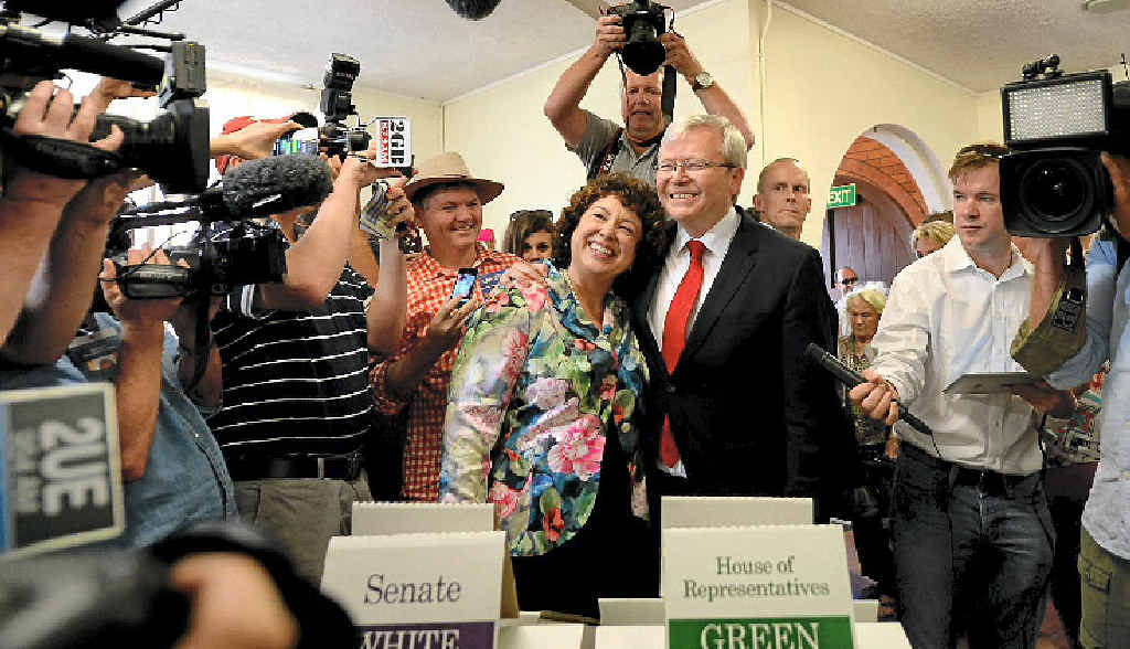 HAPPIER TIME: Prime Minister Kevin Rudd and his wife Therese Rein cast their vote at a voting centre at St Paul's Anglican church in Brisbane yesterday.
