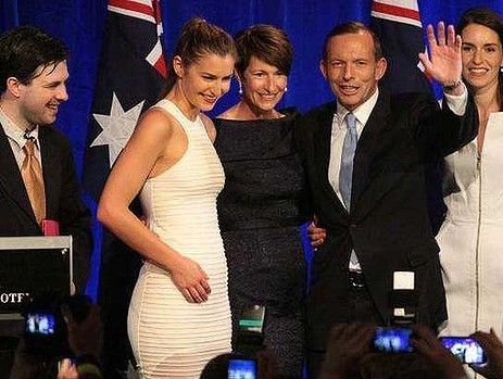 Facebook photo of 'Twiggy Palmcock' on stage photobombing the Abbott family