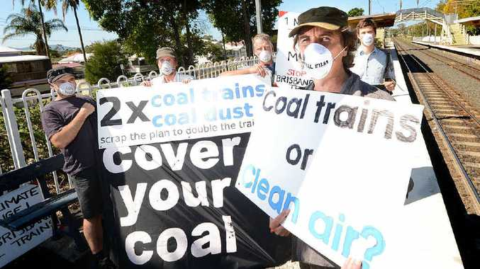 DUST UP: Spokesman for Stop Brisbane Coal Trains John Gordon with fellow members at the East Ipswich train station.