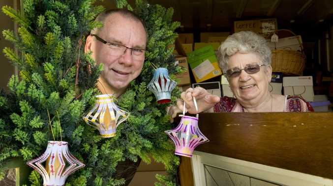 Toowoomba's Christmas Tree festival committee chair Richard Thompson with Glenda Tolley prepare for this year's festival which will be held at the Middle Ridge Uniting Church on Stenner St.