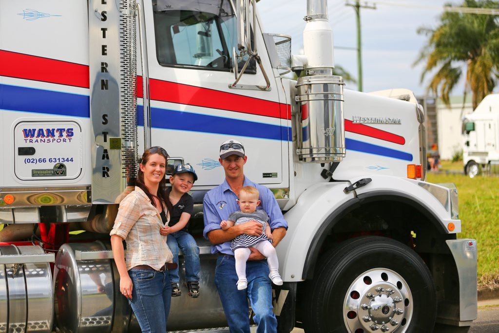 Daniel Press who drives a 19m B double for Wants transport is happy to pose for a family photo with partner Jenna, Troy(3) and Hayley(1) before last year's Casino Truck Show parade.
