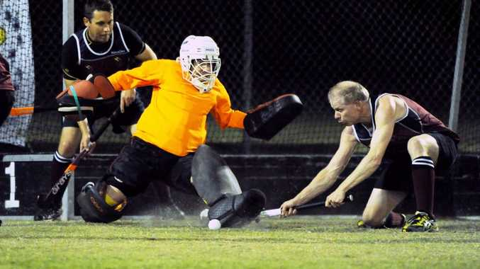 Flames goalie Simon Alloway denies the Magpies during the grand final.