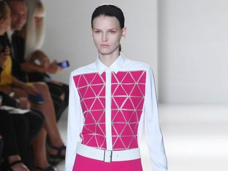 Victoria Beckham uses pops of fuchsia for effect.
