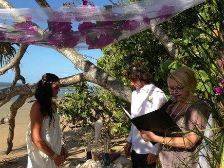 Callen White and Tina Koslowsi exchange vows with the help of civil celebrant Christine Smith.