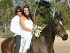 Callen White and Tina Koslowsi on horseback on their wedding day.