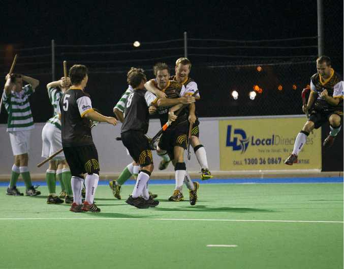 WINNING MOVE: Troy Urquart (Barbs Hagars) celebrates after scoring a goal in the men's A-grade hockey.