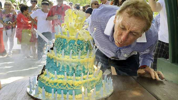 BIG BREATH: Well-known real estate business owner Garth Llewellyn blows out the 80 candles on his birthday cake.