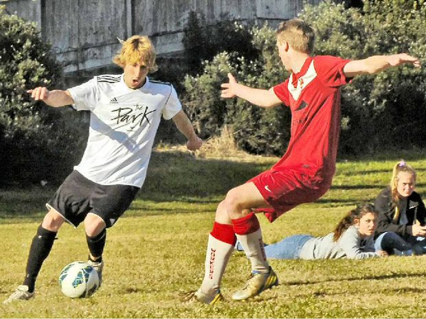 ECSTATIC: Byron Bay Rams Jonathan Pierce (left) in action this season against Lismore Workers. The two clubs will play each other again for a place in this season's men's premier division grand final.