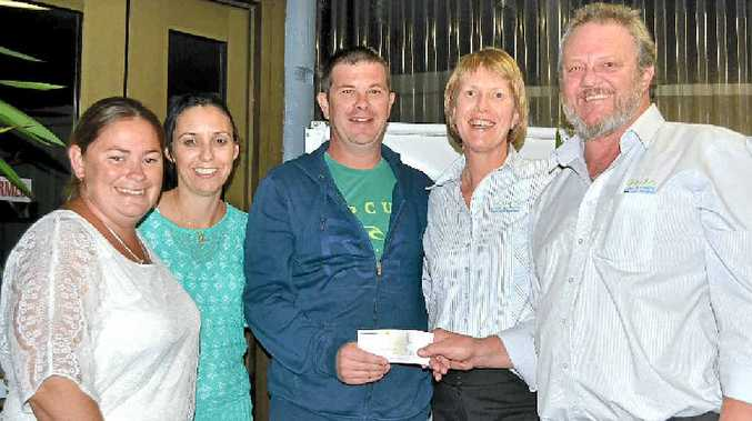 SPECIAL PRESENTATION: After all the hard work at fundraising, the final handover of $26,000 to help Jamie Griffiths (centre) get the help he needs. From left: Tracey Bodley, Rachel Griffiths, Jamie, and representatives of Evans Head Bowling Club, Margo Power and Brett Cooper.