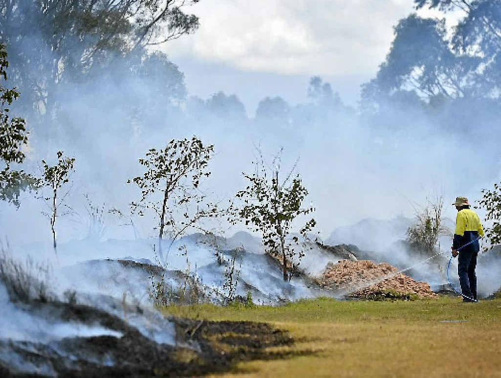 Gladstone regional council workers conduct controlled burns at Bulgwyn Park.