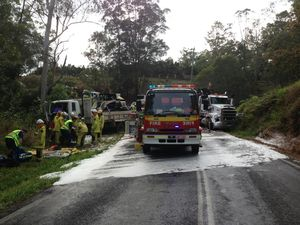 Truck driver's legs pinned after head-on crash at Mooloolah