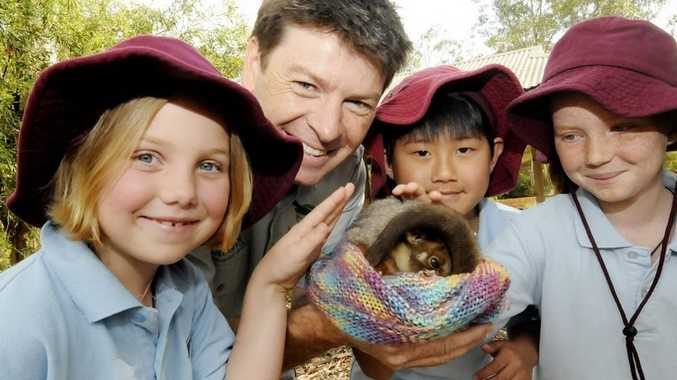 Tiki Rose from the Pocket public school, Rod Cheal from Taronga Zoo with a Ring Tail Posum, and Chung Nuyen, and Angel Harvey from the Pocket public school at Southern Cross University as part of a project to raise awareness of the plight of theatened native animals in the Northern Rivers.
