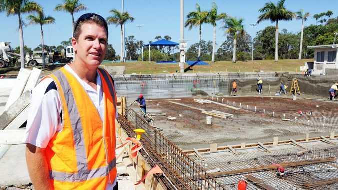 Hervey Bay Aquatic Centre manager Paul Jones checks out the concrete pour.
