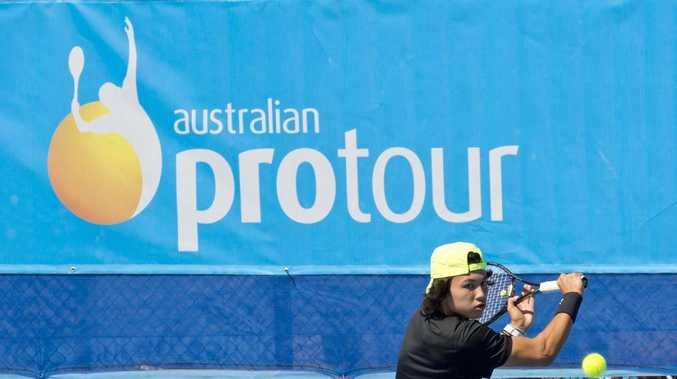 Akira Santillan heading towards victory over Jacob Grills at USQ Regional Tennis Centre yesterday.