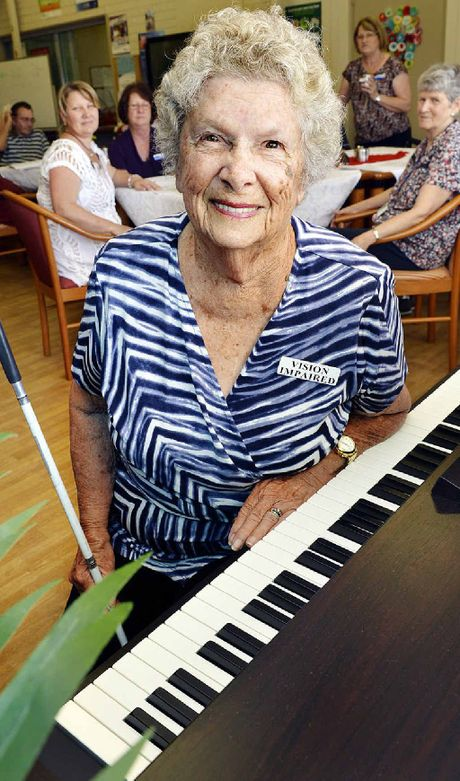 MUSIC FLOWS: Joan Cross bought an electric piano for the Blue Care Ipswich respite centre.