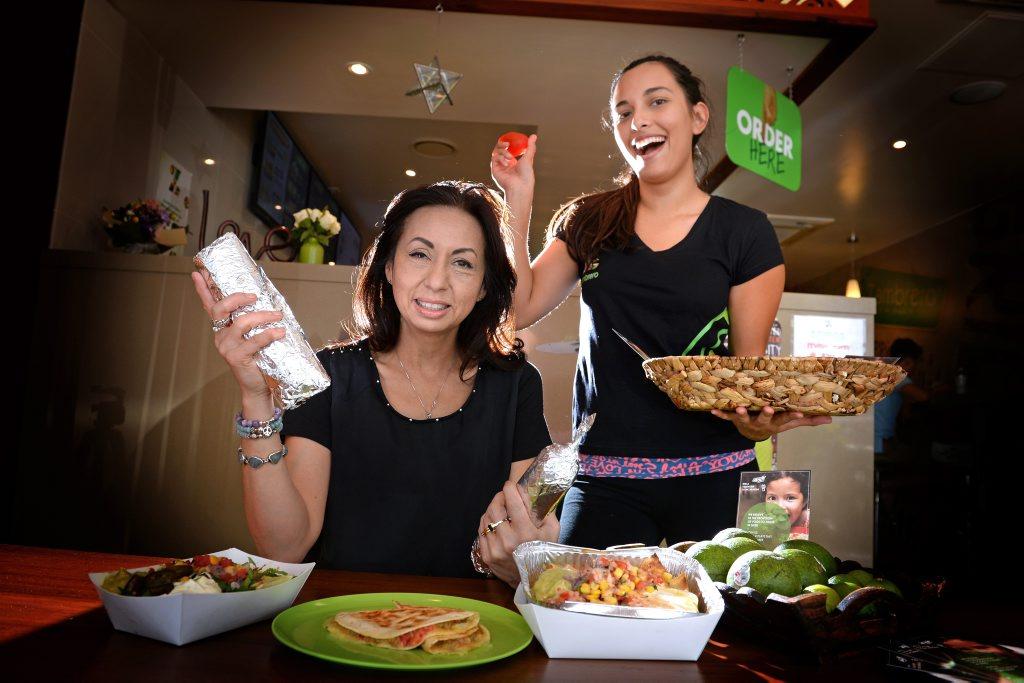 Reani Stevenson and Alexandra Trejo at Zambrero's Mexican takeaway Coolangatta for Plate4plate day. Photo: John Gass / Daily News