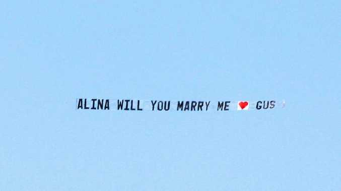 "PLANE dragging a sign, ""Alina will you marry me, Gus"" flew over Point Cartwright."