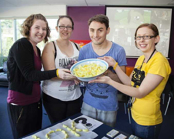 USQ Fraser Coast student ambassadors Emma Molen, Taylar Matthews and Anthony Slack with student experience officer Elle Green with a bowl of lolly bananas, which was good conversation starter.
