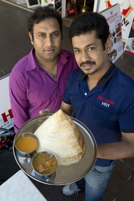 Binoy Thomas and Joshy George will celebrate the South Indian harvest festival Onam in Toowoomba on Saturday. Part of the celebrations will include serving traditional food such as cone dosas.