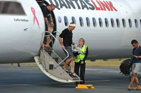 Surviviors Steve Ward and Nick Bennett disembark in Mackay after surviving an attack on the Black Cat Trail in PNG.