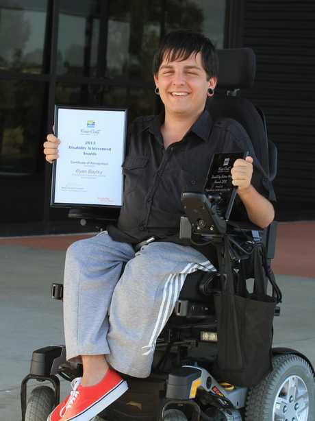 2013 Disability Achievement Awards winner Ryan Bayley with his Significant Achievement award.