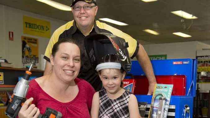 One Stop Industrial owner Dale Miller delivers the prize to Amy Markham and daughter Paige.