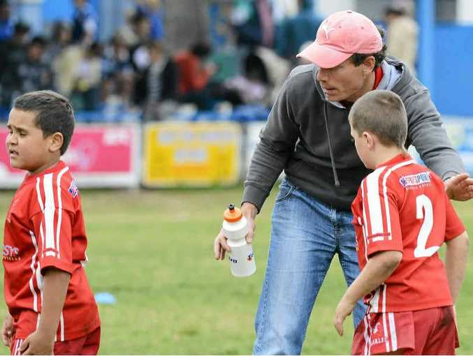 HOLY COACH: Jason Barker helps coach the South Grafton Rebels under-8's team. PHOTO: Debrah Novak