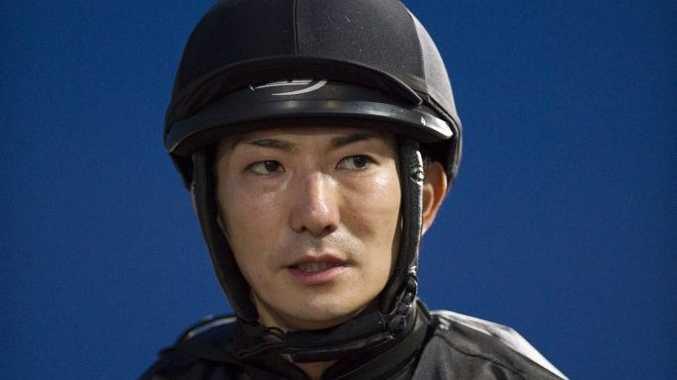 Jockey Nozi Tomizawa injured in a race-three fall at Clifford Park yesterday.