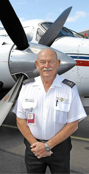 Pilot Graham Vonhoff with his trusty Beechcraft King Air as he retires from the Royal Flying Doctor Service.