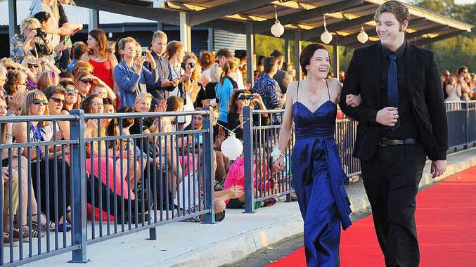 DRESSED UP: Amy Hauser and Zack Weeding strut the red carpet at the Xavier Catholic College Formal.