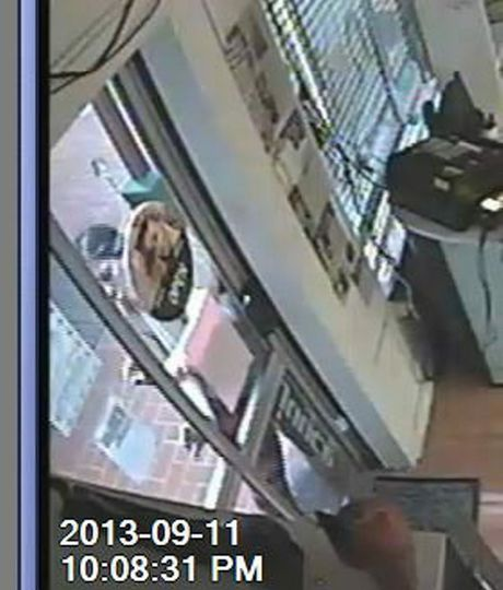 A woman is seen in this CCTV trying to break into the Turning Heads Hair Design shop on Drayton Rd.