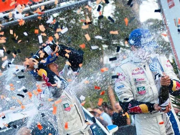 VICTORY: Sebastian Ogier and navigator Julian Ingrassia celebrate after winning the Australian Rally in Coffs Harbour.