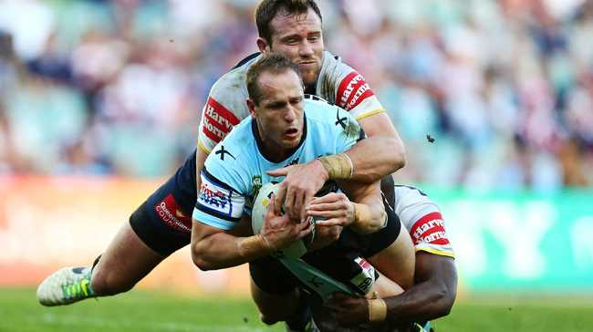 Jeff Robson of the Sharks is tackled during the NRL Elimination Final match between the Cronulla Sharks and the North Queensland Cowboys.