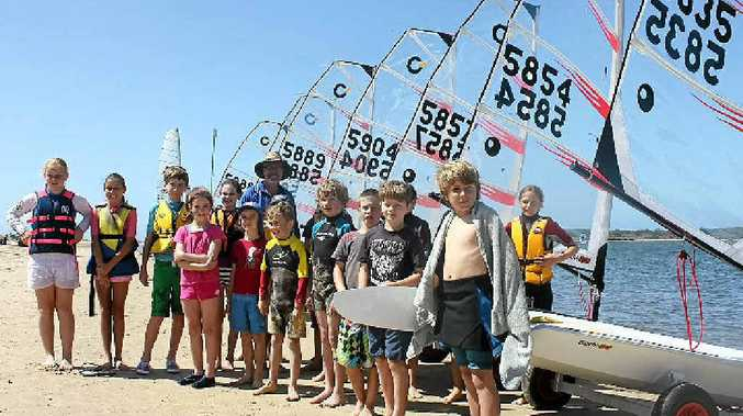 BIG BOATS: Brandon McKeown with kids at the Richmond River Sailing and Rowing Club and their new training boats.