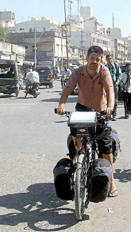 Matthew Brice on his bike in Porbandar, India, 2012.