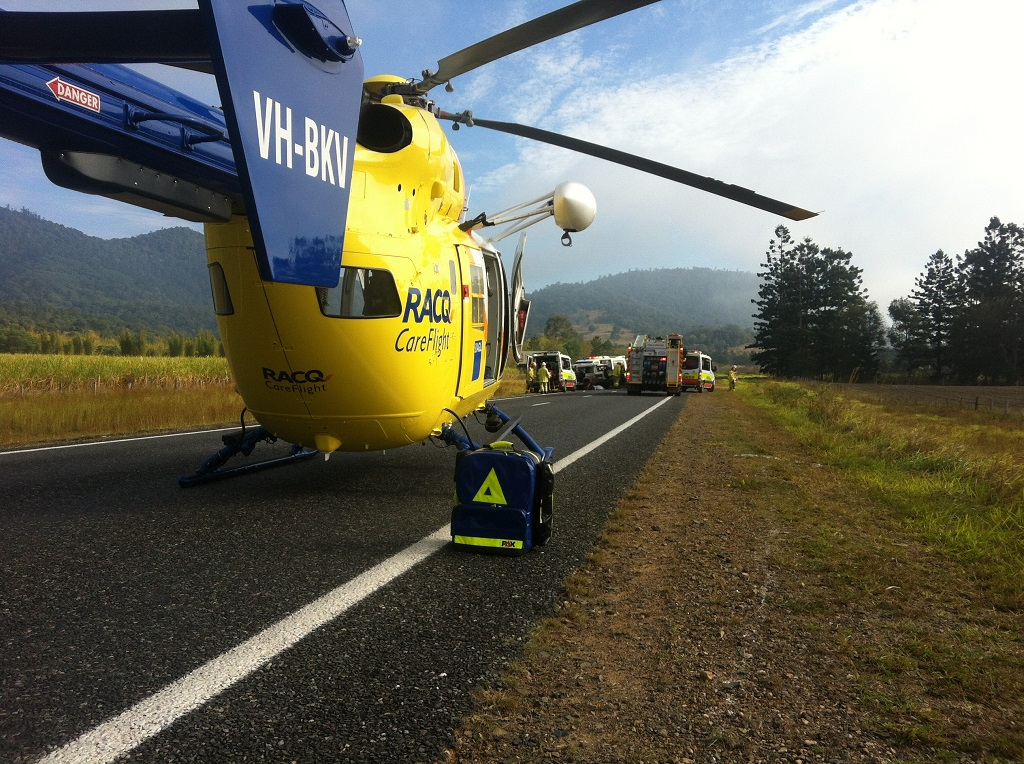 The RACQ Careflight Rescue helicopter at the scene of a four-wheel drive rollover on the Bruce Hwy.