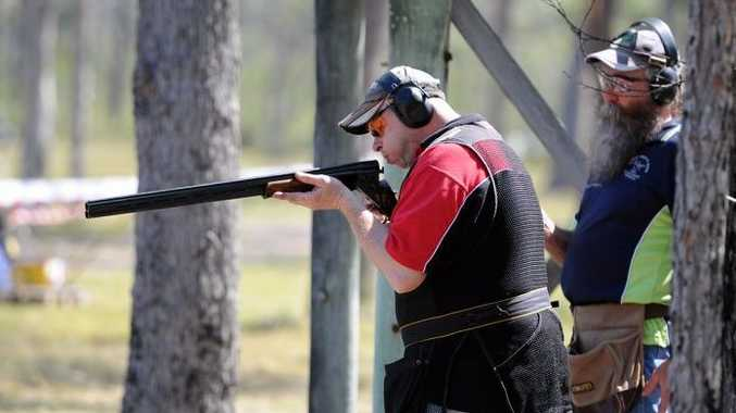 Dennis Dinte blows his gun clear of debris at the Fraser Coast Shooters Complex in Dundathu.