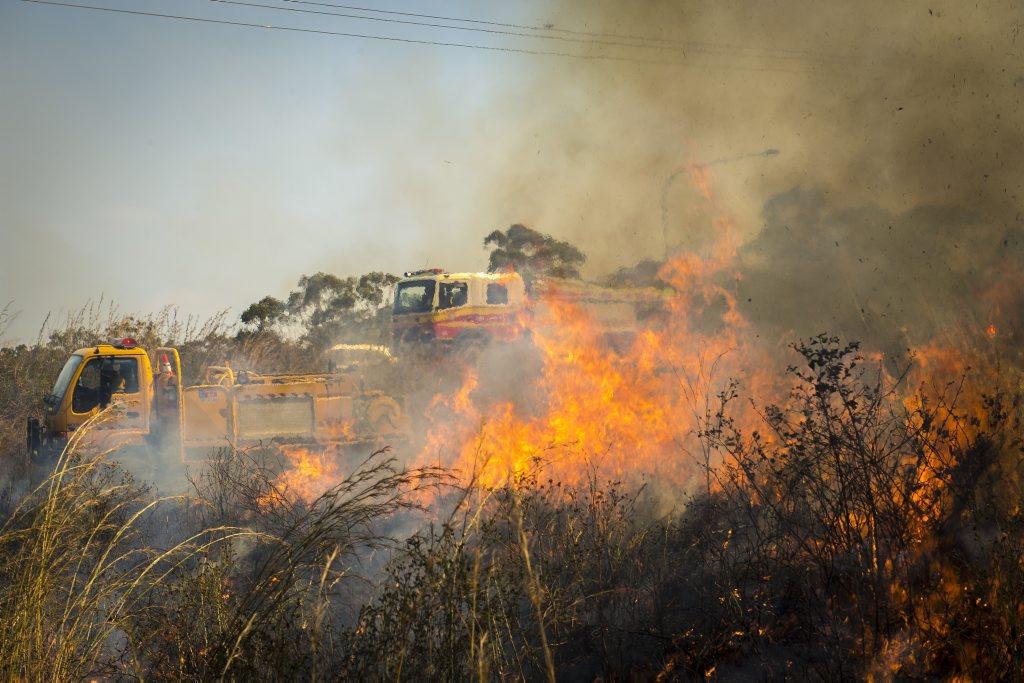 Precautionary backburning efforts to fight the Gladstone-Benaraby Rd fire.
