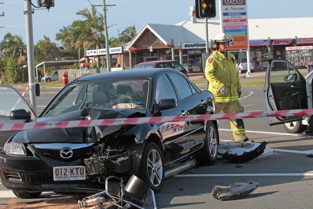 Alleged carjacker crashes into a traffic light on the corner of Nicklin Way and Kawana Island Boulevard, Warana.