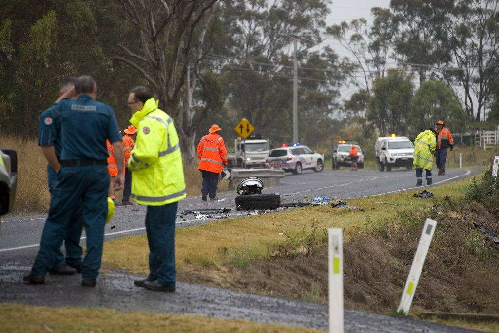 Emergency services at the scene of a crash where a woman has been killed and three children seriously injured after a truck and a 4WD collided on the New England Hwy, just south of Toowoomba, Monday, September 16, 2013. Photo Kevin Farmer / The Chronicle