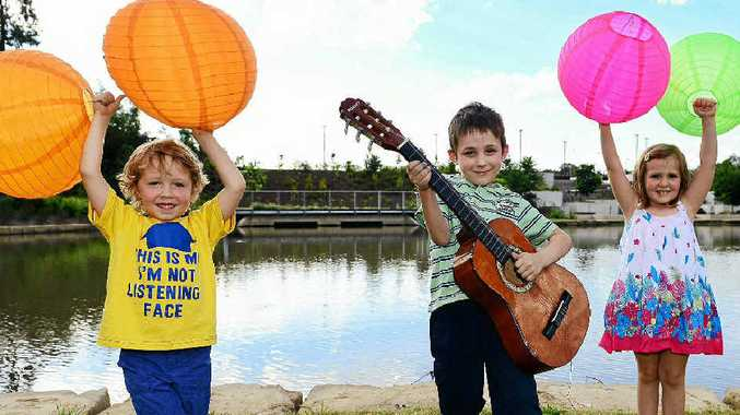 BAND FEVER: Excited about the lantern festival and Battle of the Bands (from left) are Stanley Roslin-Clark, 4, Noah Barnes, 6, and Zoe Gibson, 4.