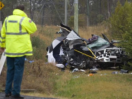 A woman has been killed and three children seriously injured after a crash involving a car and truck on the New England Hwy.