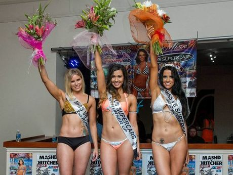 Our Miss V8 Supercar winners celebrate on-stage.