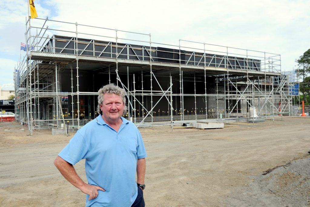 The Beach House Hotel site manager John Lynam stands in front of the bottle shop under construction on the Scarness Esplanade site.