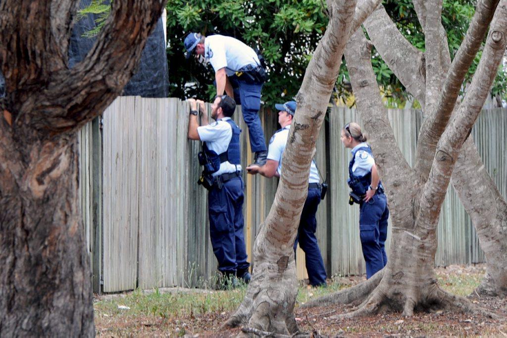 Police searching backyards in Kawungan.