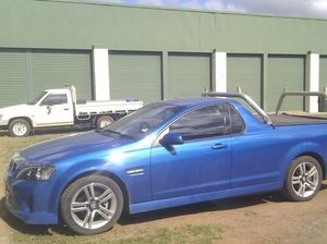 Blue Commodore ute stolen from Emerald business on weekend