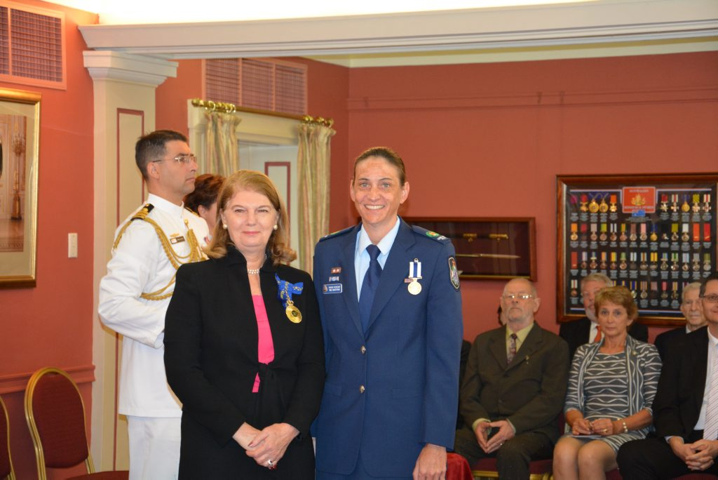 Senior Sergeant Meg Jane McArthur - accepts the Australian Police Medal for outstanding dedication and commitment to the Queensland Police Service, particularly in the areas of improving policing of Indigenous communities and in operational policing, organisational improvement and performance management. She was appointed Officer-in-Charge at Woorabinda Police Station in 2007, becoming the first female police officer in Queensland to take up such a position in an Indigenous community. Photo Rae Wilson / Newsdesk
