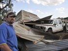 Maclagan resident Syd Collins inspects his shed after it was blown down by strong winds. Photo Stuart Cumming / The Chronicle
