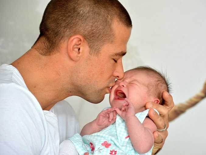 Matt's twin brother Luke Filippi with his newborn daughter Ruby.
